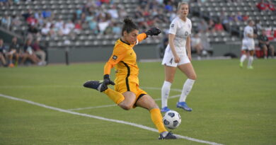 Racing Louisville GK Michelle Betos goal kick with Gemma Bonner watching in the background