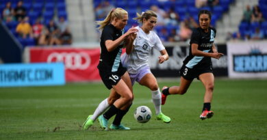 Emily Fox and Allie Long fight for the ball