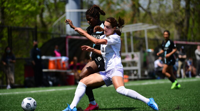 Emily Fox pushes past a Gotham player to take control of the ball