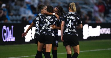 Racing Louisville teammates Nadia Nadim and Cece Kizer embrace on the pitch flanked by Gemma Bonner and Jorian Baucom