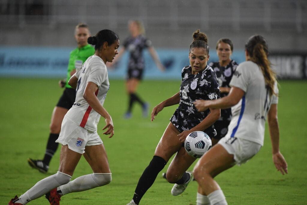 Jorian Baucom attempts to move possess the ball past Sofia Huerta