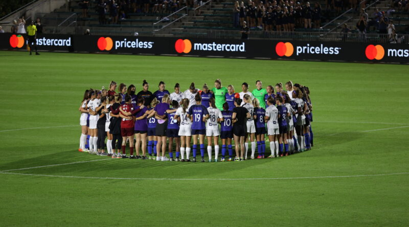 Courage and Racing Louisville players stand together in protest